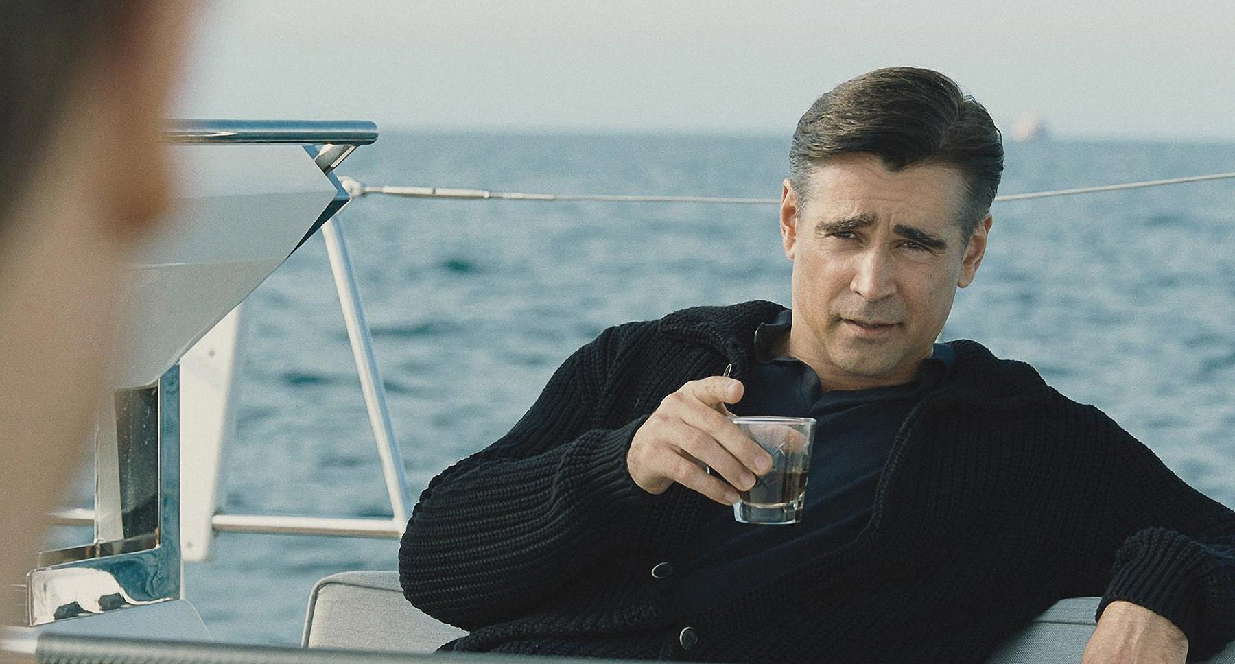 "Colin Farrell with a drink on a boat in ""Widows"""