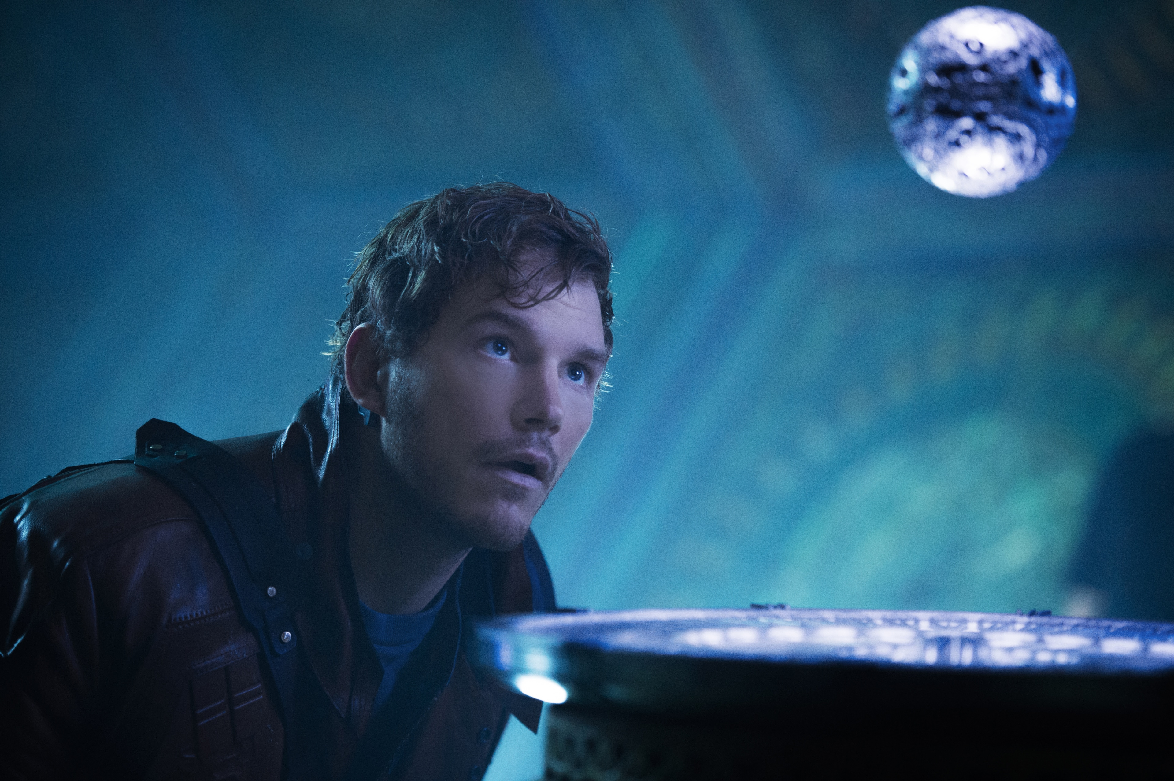Peter Quill (Starlord) staring at a floating orb