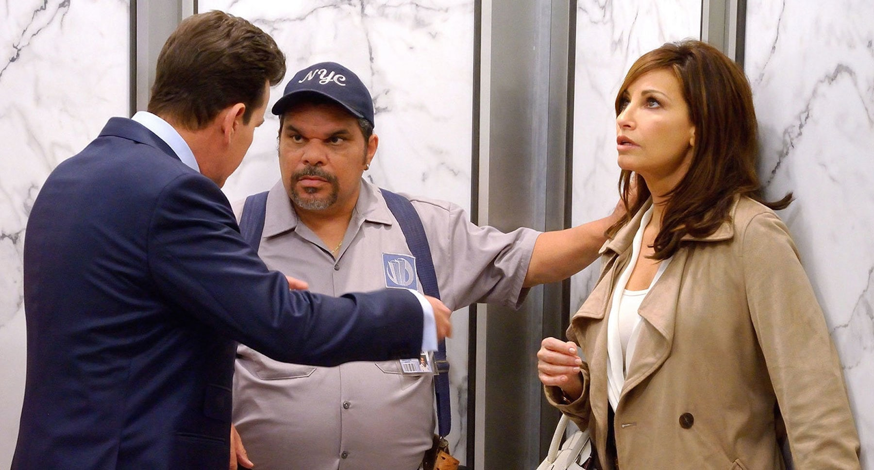 "Actors Charlie Sheen (Jeffery Cage), Luis Guzmán (Eddie), and Gina Gershon (Eve)in the film ""9/11"""