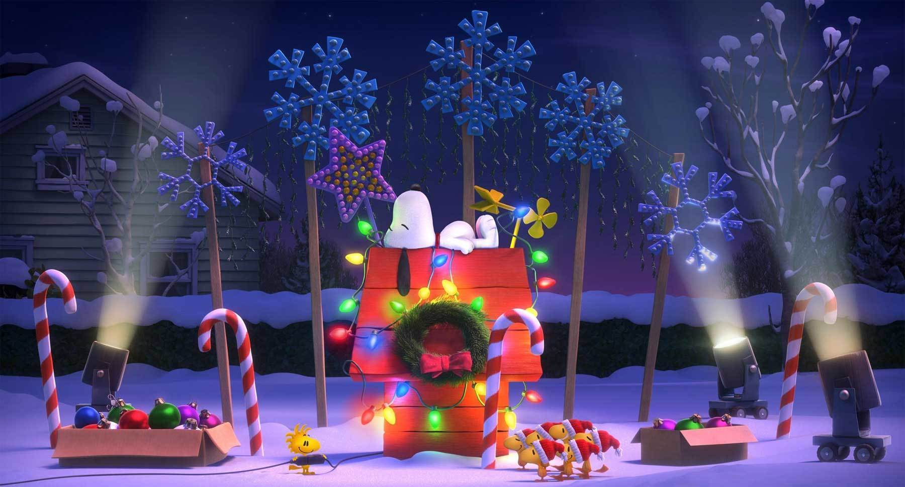 "Snoopy and Woodstock (both voiced by Bill Melendez) lighting up Snoopy's doghouse in ""The Peanuts Movie"""