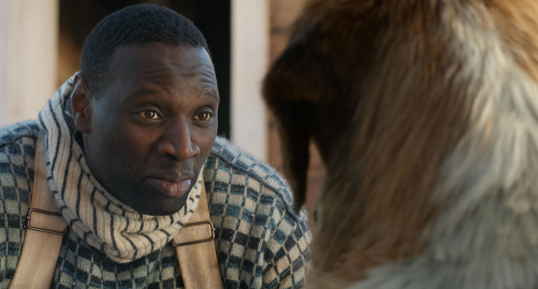 "Actor Omar Sy (as Perrault) with Buck, the dog from the movie ""The Call of the Wild"""