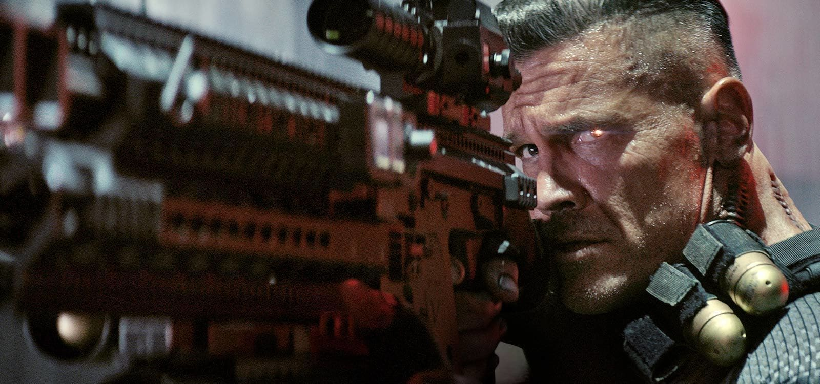 "Actor Josh Brolin (as Cable) aiming a gun in the film ""Deadpool 2"""
