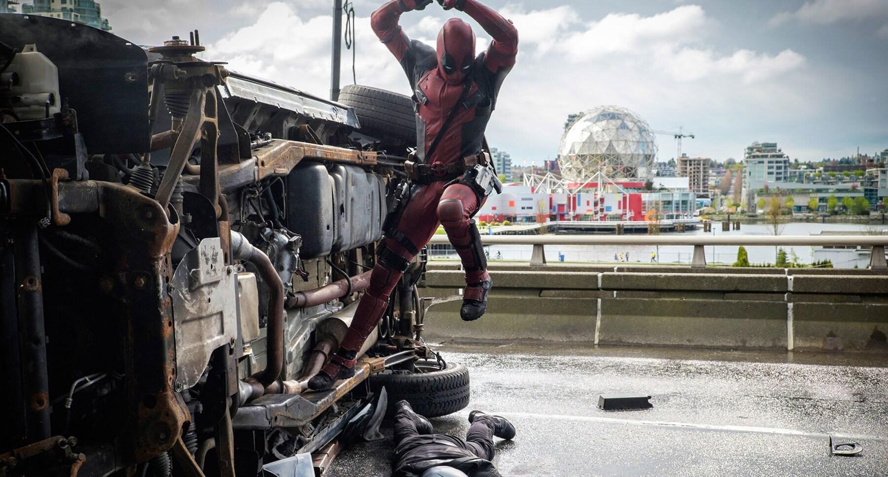 "Ryan Reynolds (as Deadpool) jumping off a car in ""Deadpool"""