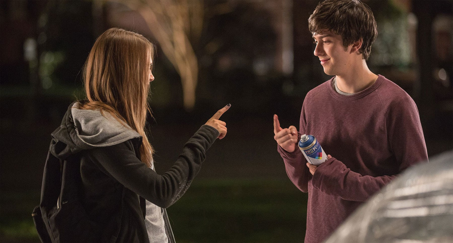 "Nat Wolff (as Quentin) and Cara Delevingne (as Margo) with a can of spray paint in ""Paper Towns"""