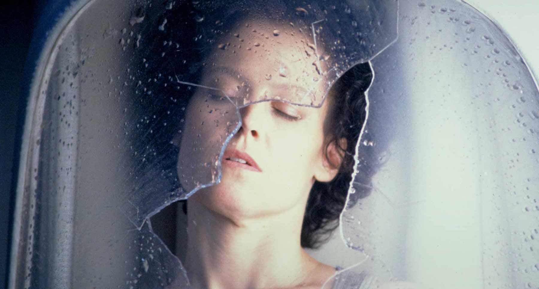 "Actor Sigourney Weaver (as Ripley) sleeping in a broken tube in the film ""Alien3"""