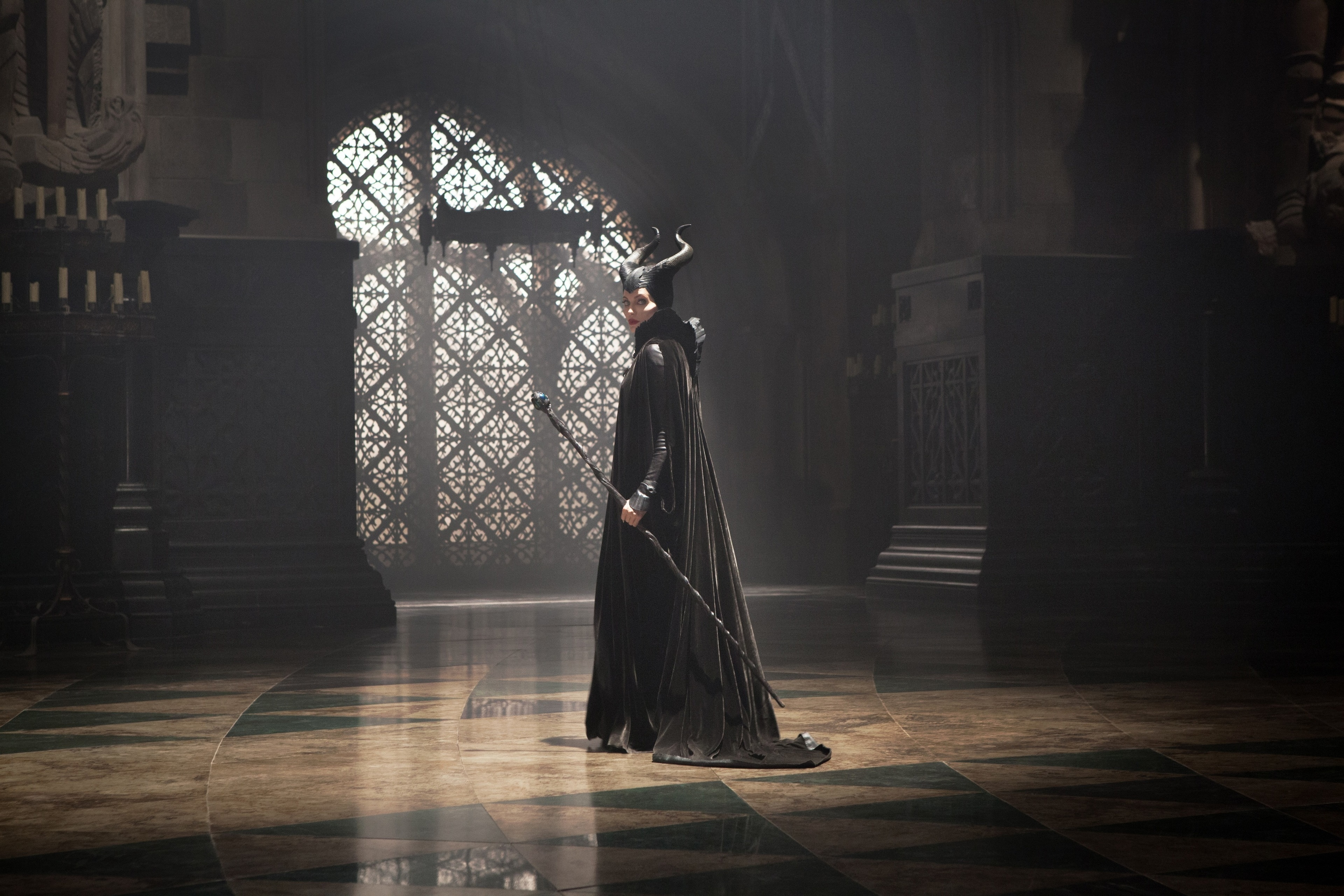 """Angelina Jolie as Maleficent in room in the castle, looking back in the movie """"Maleficent"""""""