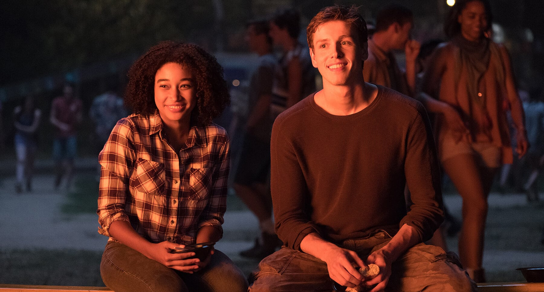 "Actors Amandla Stenberg (as Ruby Daly) and Harris Dickinson (as Liam Stewart) in the movie ""The Darkest Minds"""