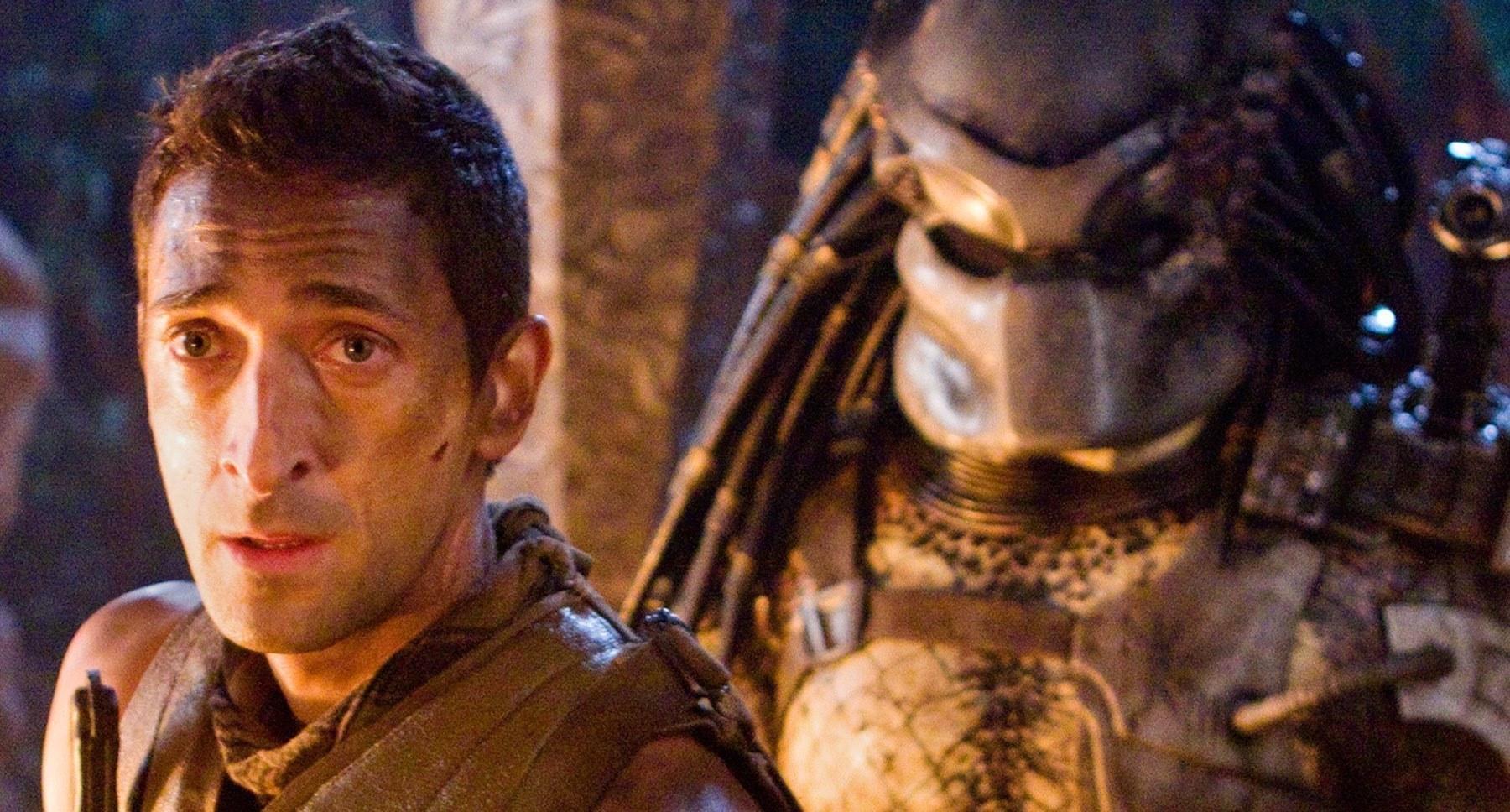 """Adrien Brody (as Royce) standing with a Predator behind him in """"Predators"""""""