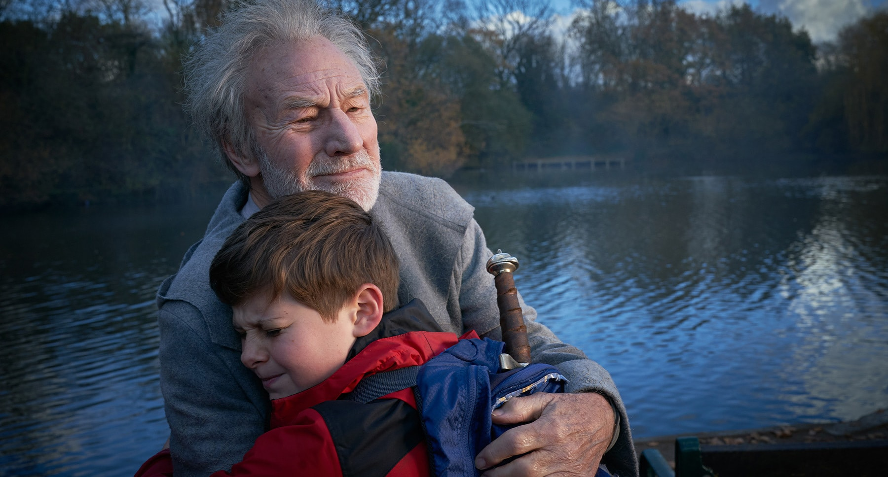 "Adult Merlin (Patrick Stewart) and Alex (Louis Ashbourne Serkis) in the movie ""The Kid Who Would Be King"""