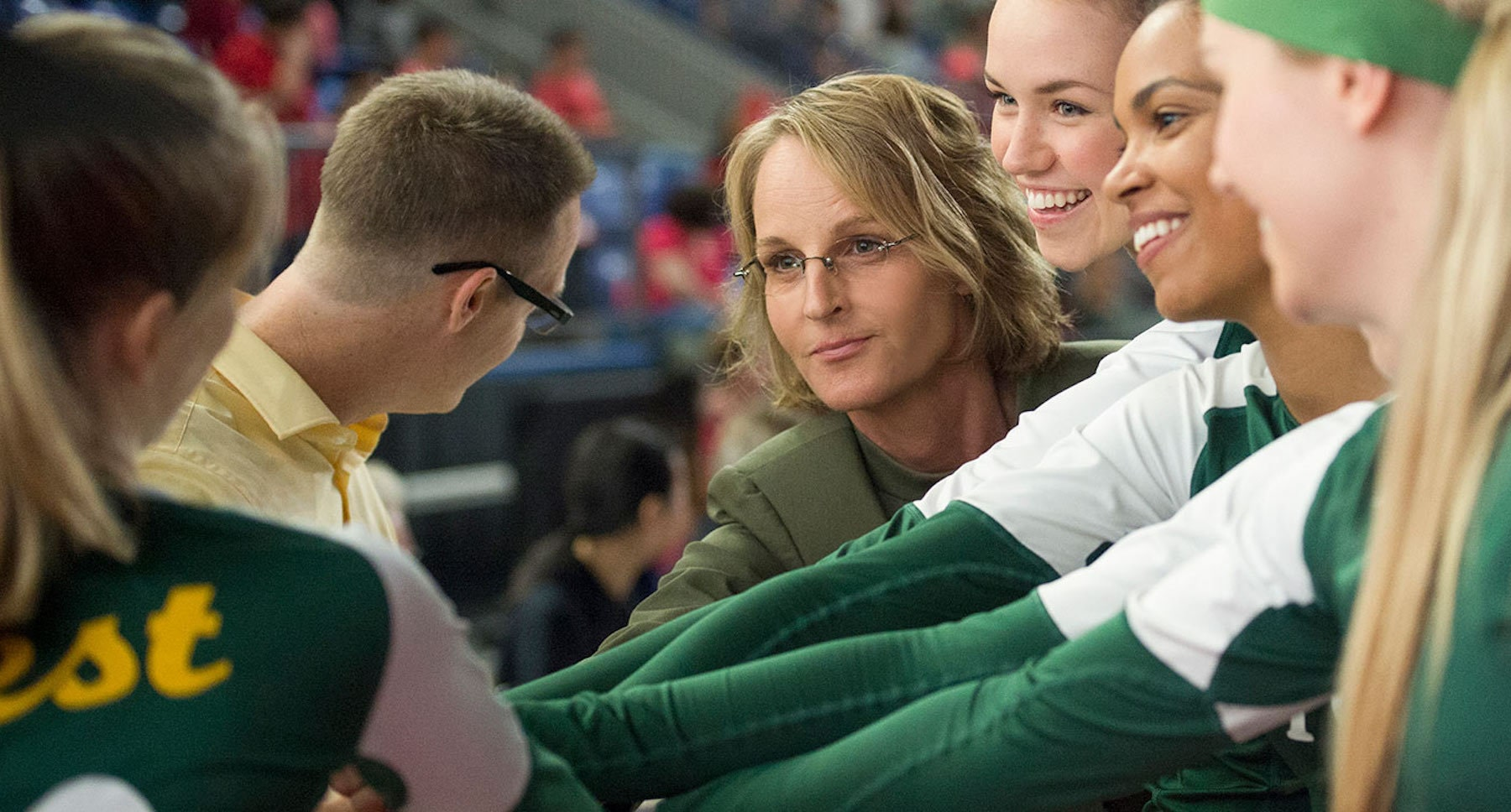 "Actor Helen Hunt (as Kathy Bresnahan) with the girls volleyball team in the movie""The Miracle Season"""