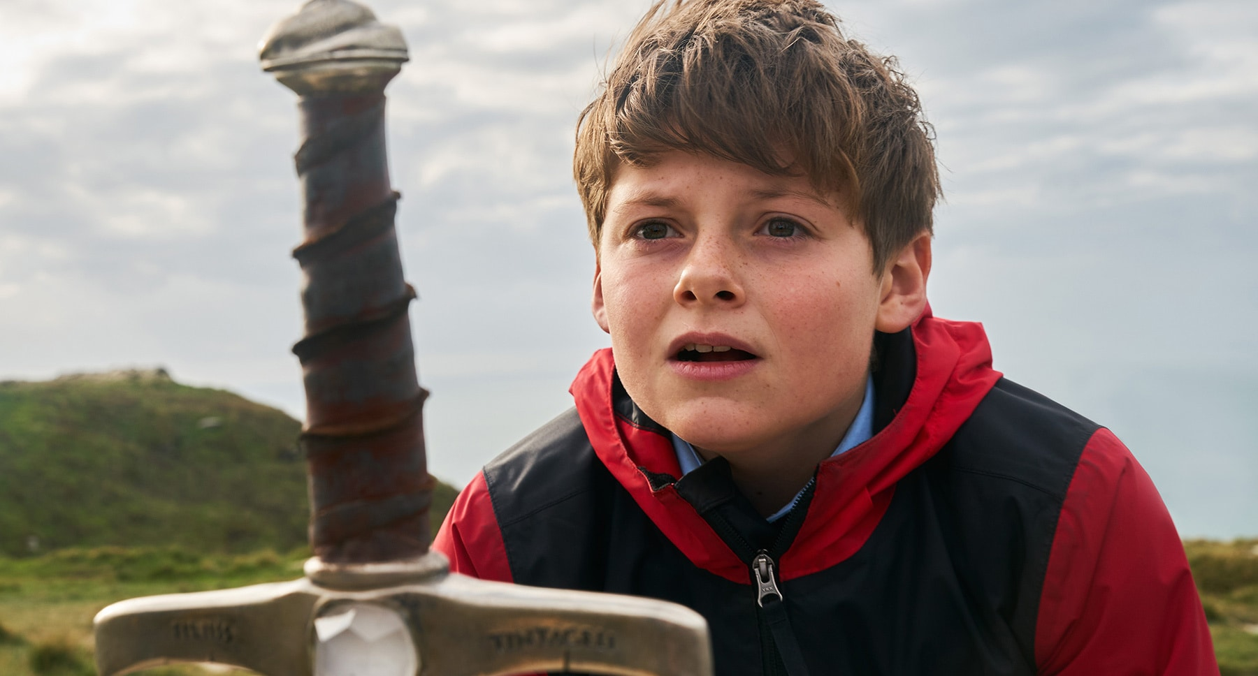 "Alex, played by actor Louis Ashbourne Serkis, in the movie ""The Kid Who Would Be King"""