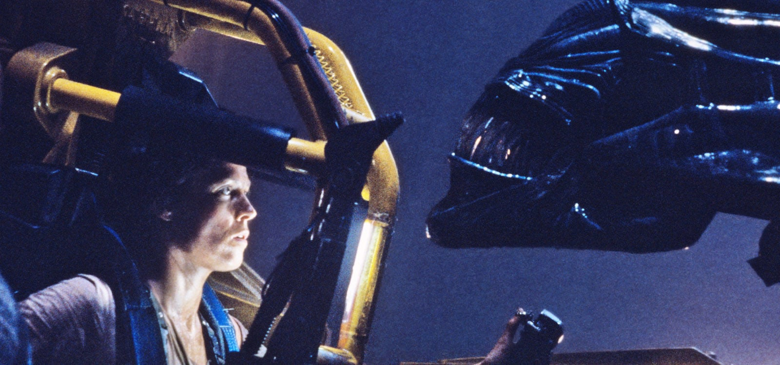 "Actor Sigourney Weaver (as Ridley) wearing Powerloader suit facing an Alien in the film ""Aliens"""