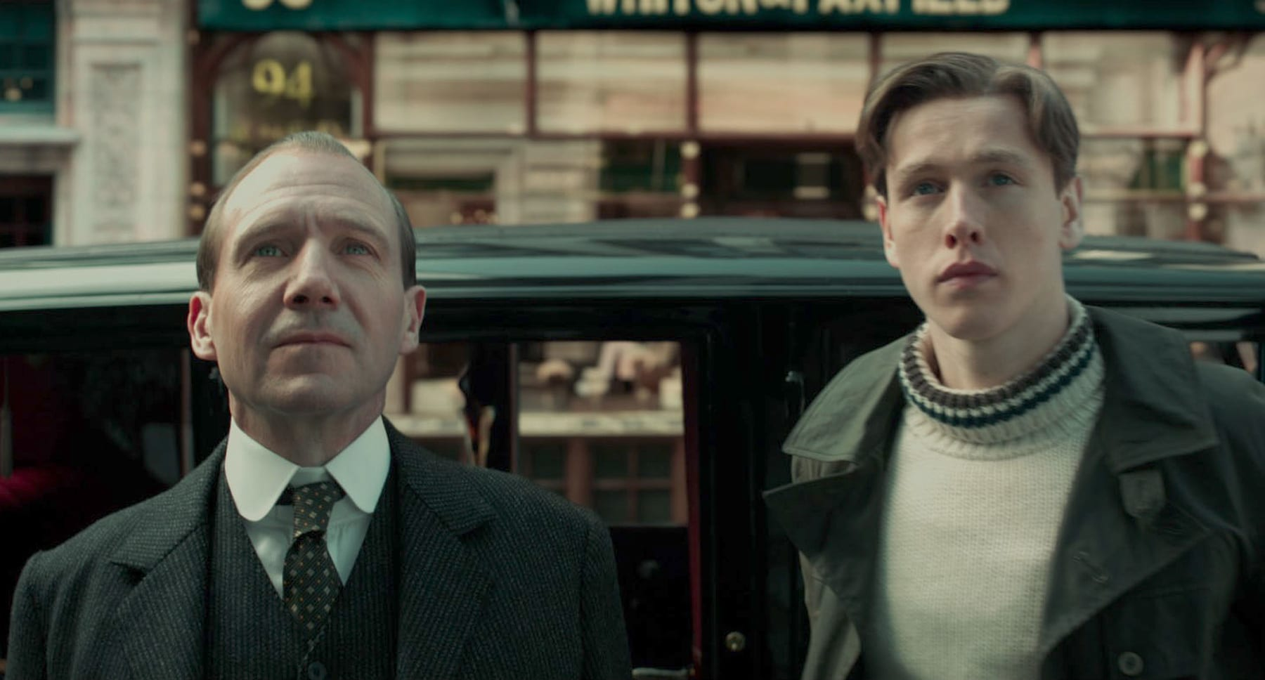 "Ralph Fiennes (as Duke of Oxford) and Harris Dickinson (as Conrad) in the movie ""The King's Man"""