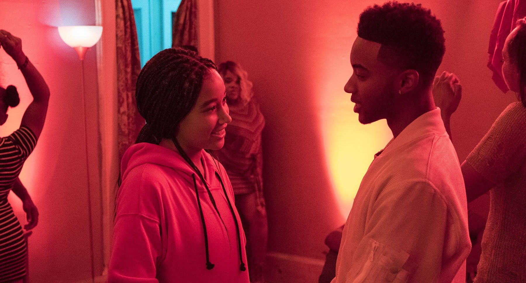 "Starr Carter (Amandla Stenberg) looking at Khalilm (Algee Smith) in the movie ""The Hate U Give"""