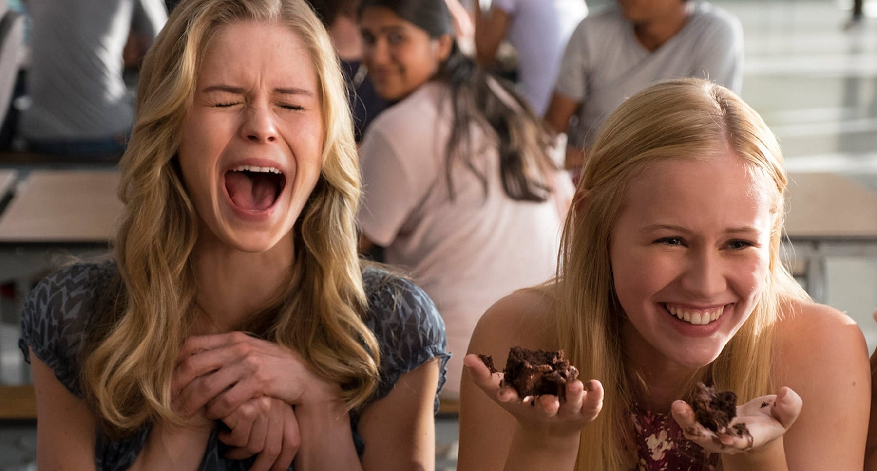"Two girls laughing in the movie ""The Miracle Season"""