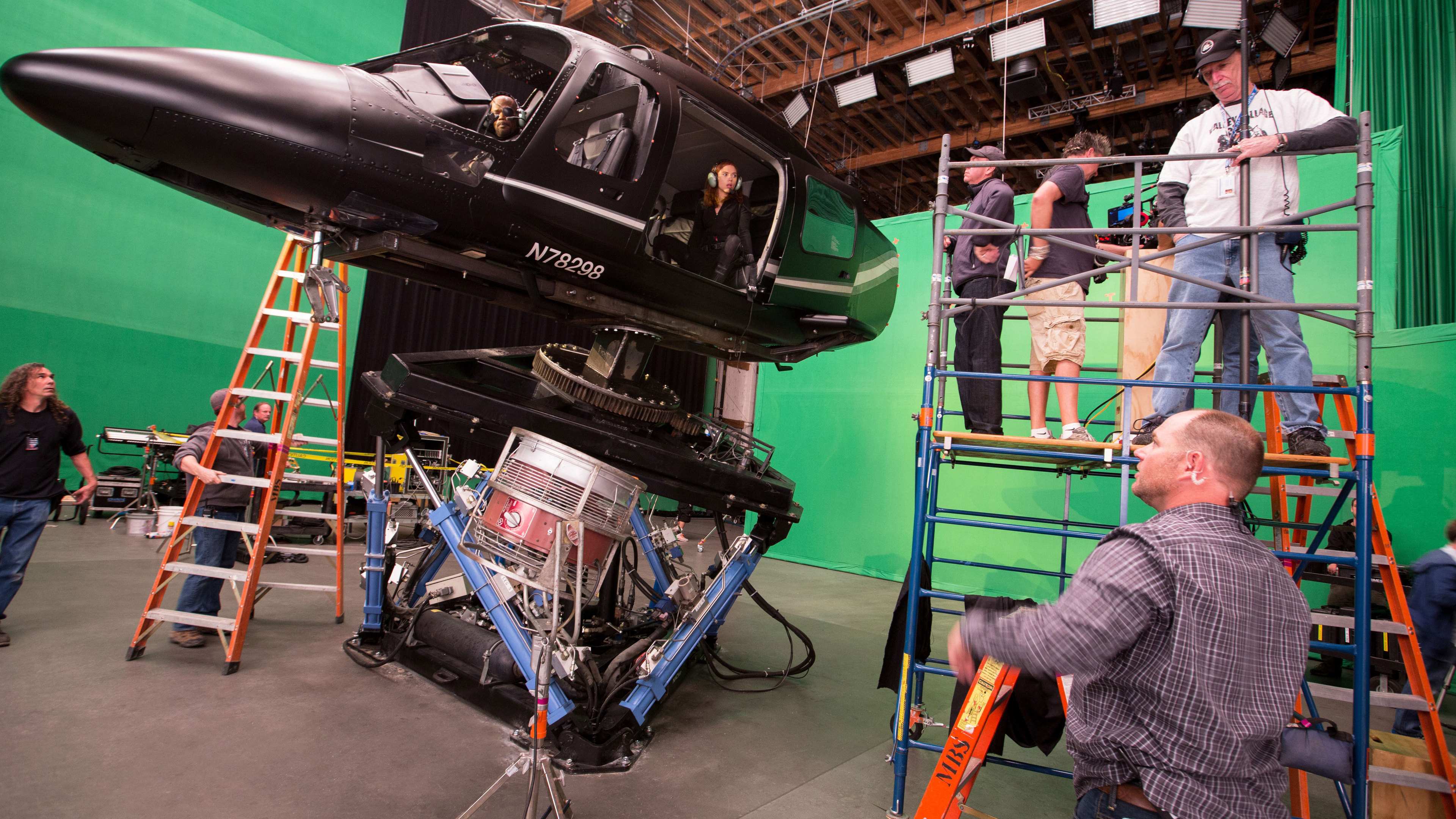 Behind-the-scenes photo of actors Samuel L. Jackson (Nick Fury) and Scarlett Johansson (Natasha Romanoff/Black Widow) in Captain America: The Winter Soldier.