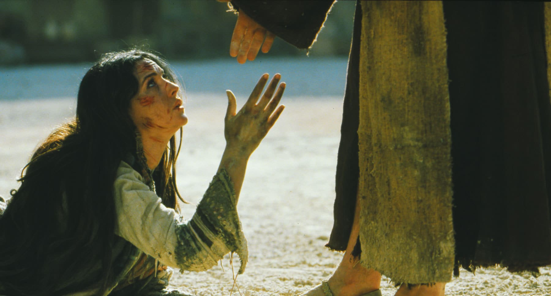 "Woman on the ground at Christ's feet in the movie ""The Passion of the Christ"""