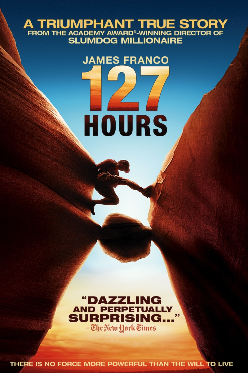"""127 Hours Movie Poster; A Triumphant true story from academy award-winning director or Slumdog Millionaire; James Franco; Image of Franco climbing between two cliff sides with a rcok wedged btween them underneath him; """"Dazzling and perpetually surprising..."""" The New York times; there is no force more powerful than the will to live."""""""
