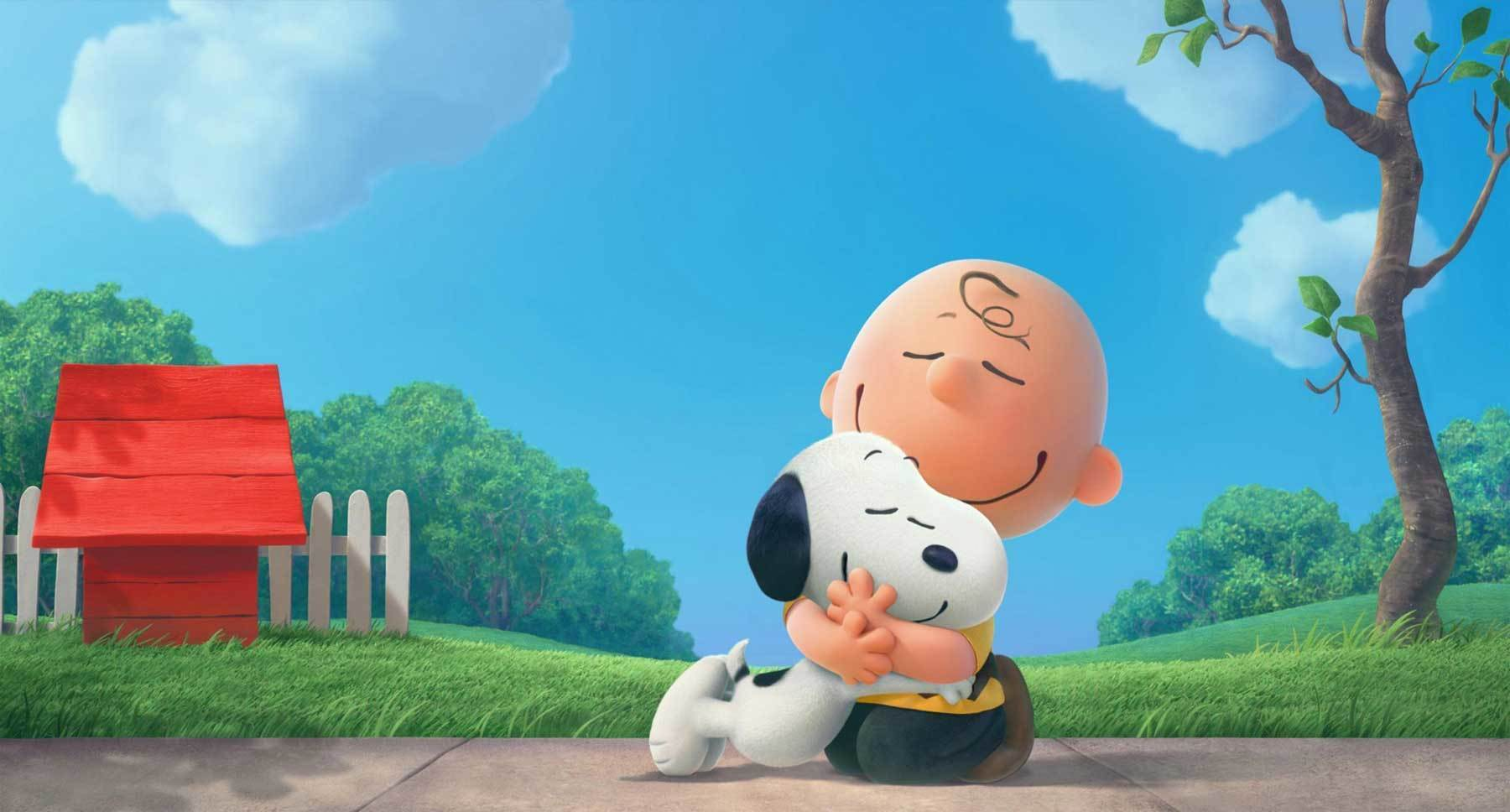 "Snoopy (voiced by Bill Melendez) and Charlie Brown (voiced by Noah Schnapp) hugging in a scene from ""The Peanuts Movie"""