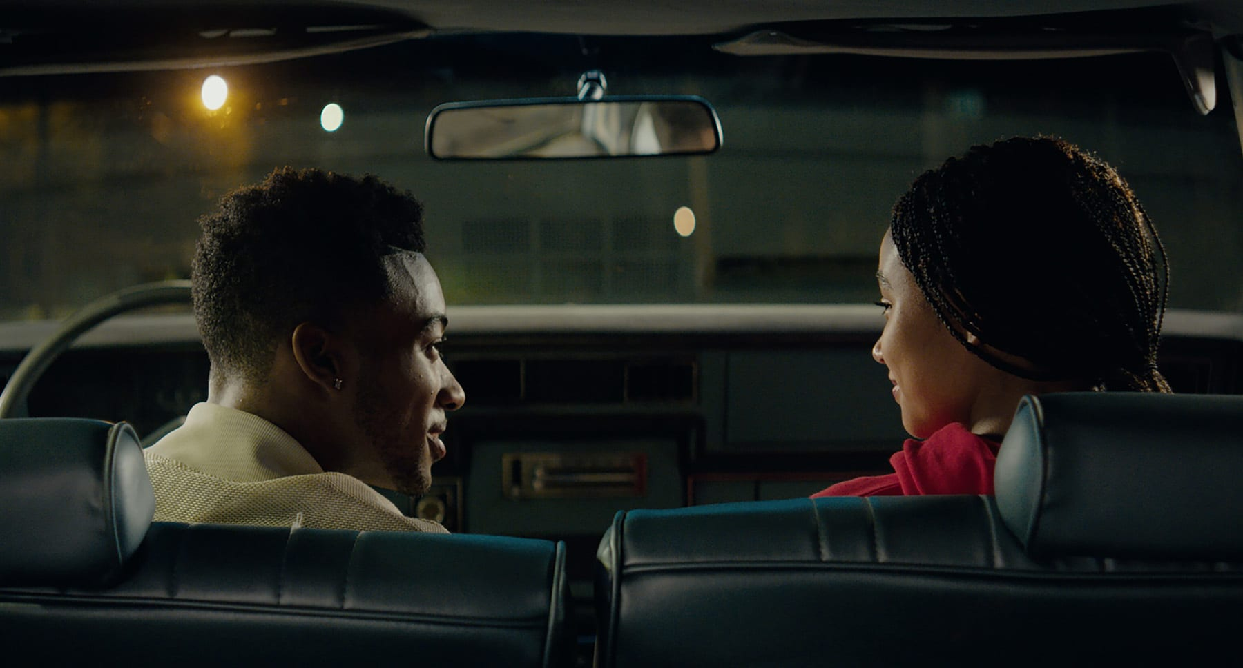 "Starr Carter (Amandla Stenberg) and Khalilm (Algee Smith) sitting in a car in the movie ""The Hate U Give"""