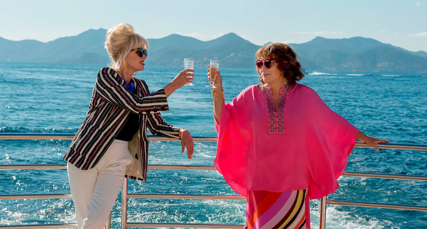 "Actors Jennifer Saunders (Edina) and Joanna Lumley (Patsy) toasting in ""Absolutely Fabulous: The Movie"""