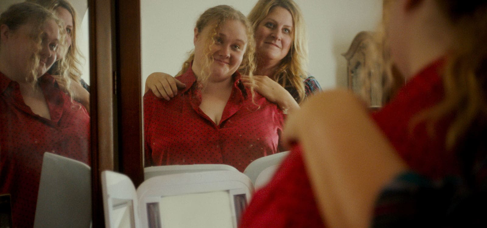 "Bridget Everett (as Bard) and Danielle Macdonald (as Patti) looking into a mirror in the movie ""Patti Cake$"""