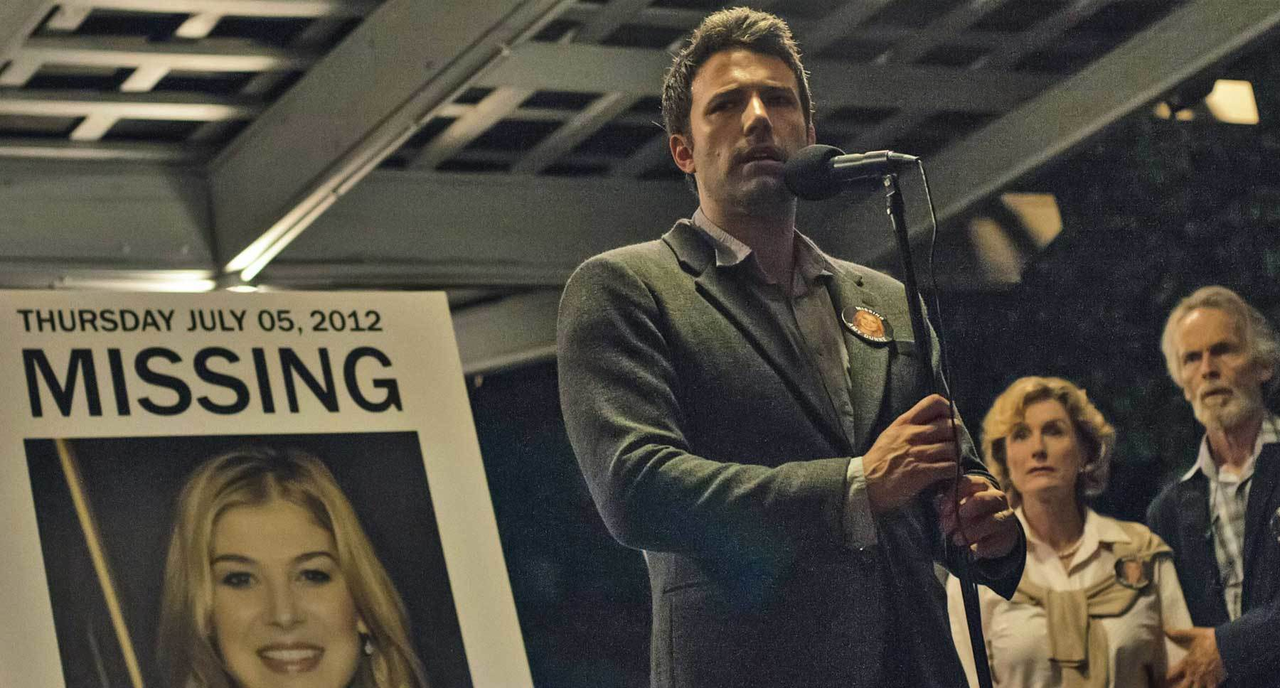 "Ben Affleck (Nick) speaking into a microphone in ""Gone Girl"""