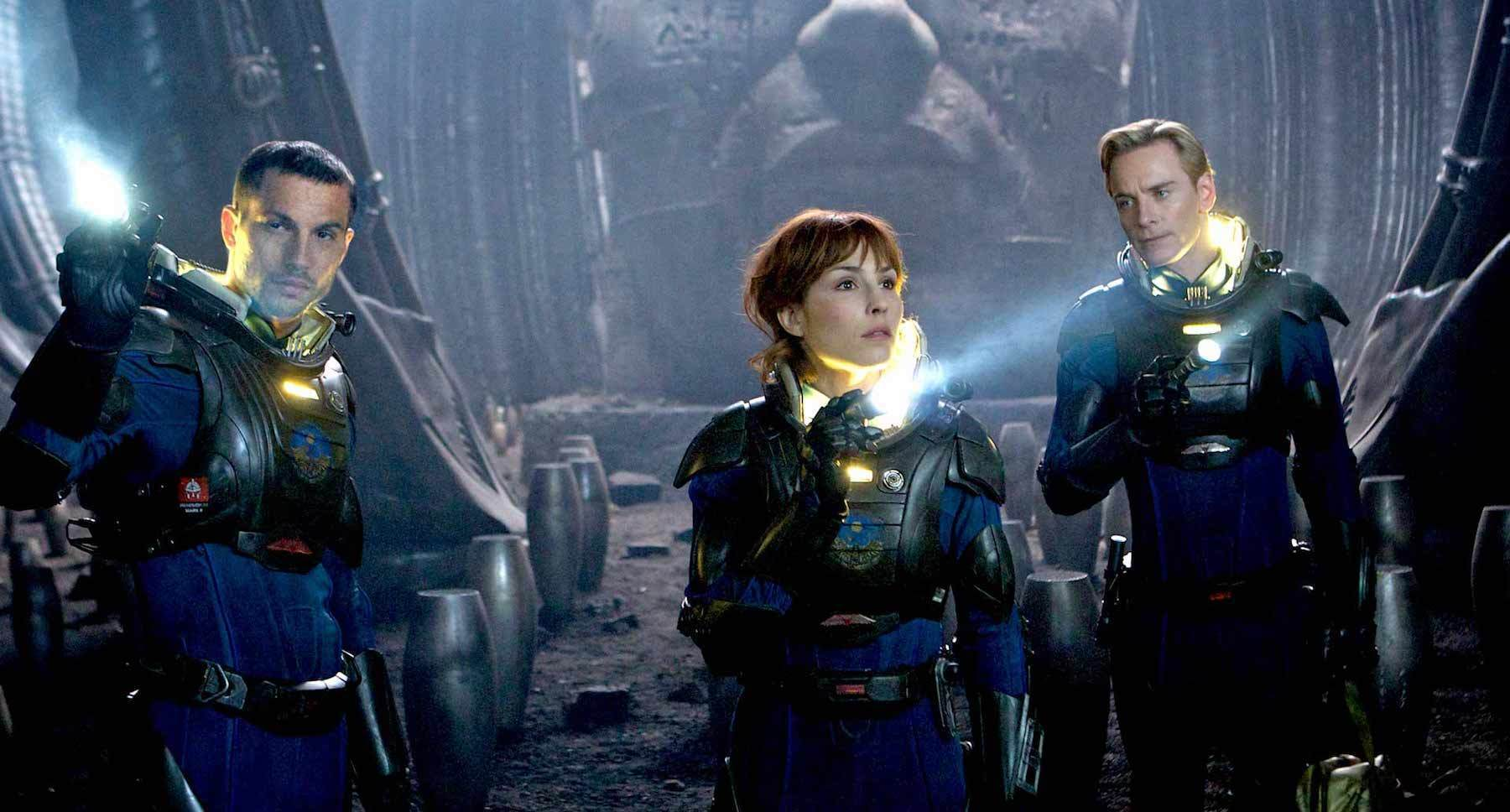 "Noomi Rapace (as Elizabeth Shaw), Michael Fassbender (as David), and Logan Marshall-Green (as Charlie Holloway) in ""Prometheus"""