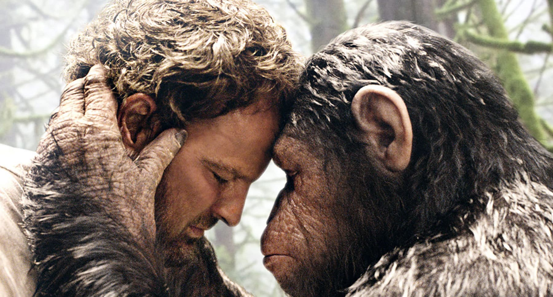 "Actors Andy Serkis (as the ape Caesar) and Jason Clarke (as Malcolm) embracing in the film ""Dawn Of The Planet Of The Apes"""