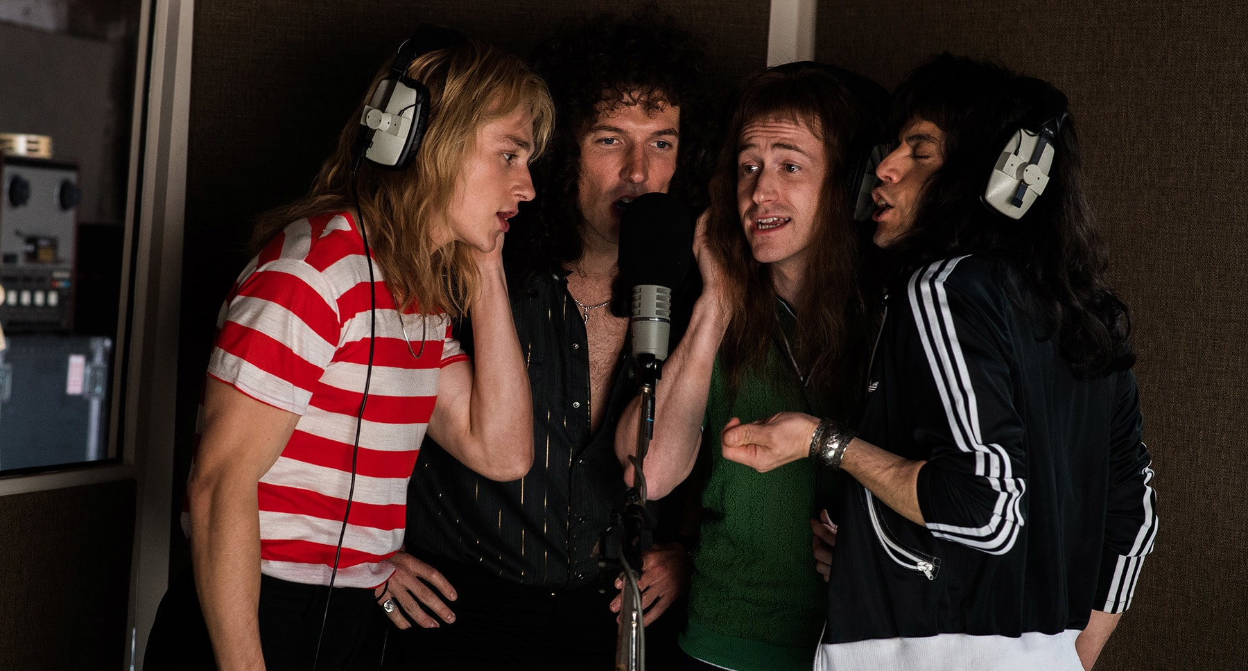 "Rami Malek (as Freddie Mercury) Gwilym Lee (as Brian May), Ben Hardy (as Roger Taylor), and Joseph Mazzello (as John Deacon) singing in the movie ""Bohemian Rhapsody"""