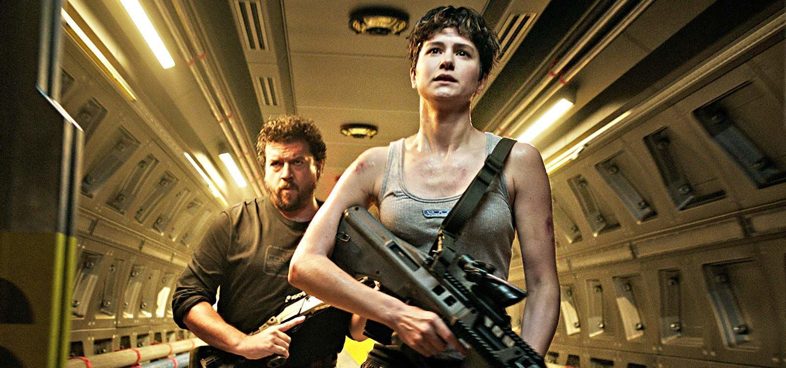 "Actors Katherine Waterston (as Daniels) and Danny McBride (as Tennessee) holding guns in the film ""Alien: Covenant"""
