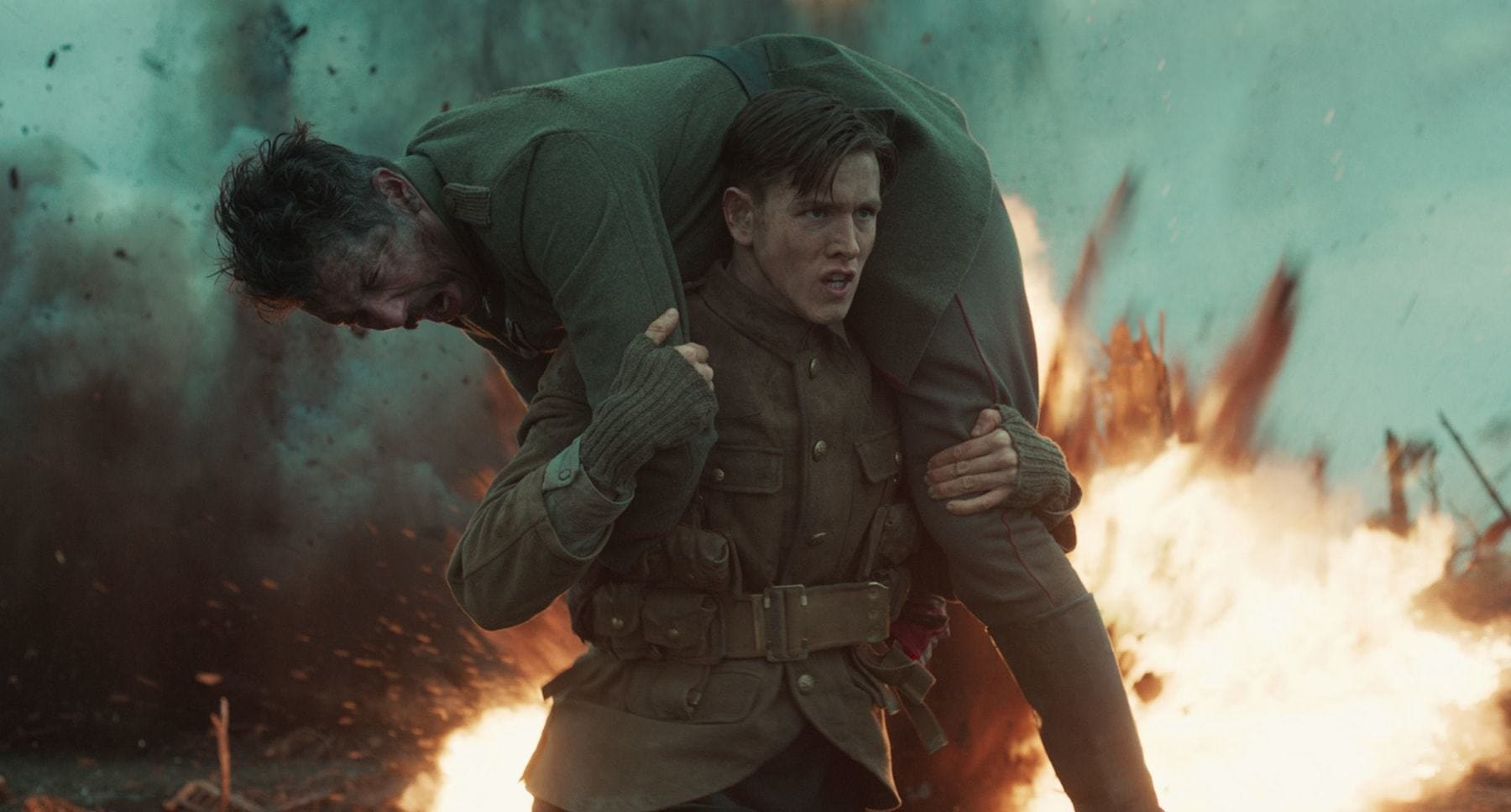 "Harris Dickinson (as Conrad) carrying a soilder in the movie ""The King's Man"""