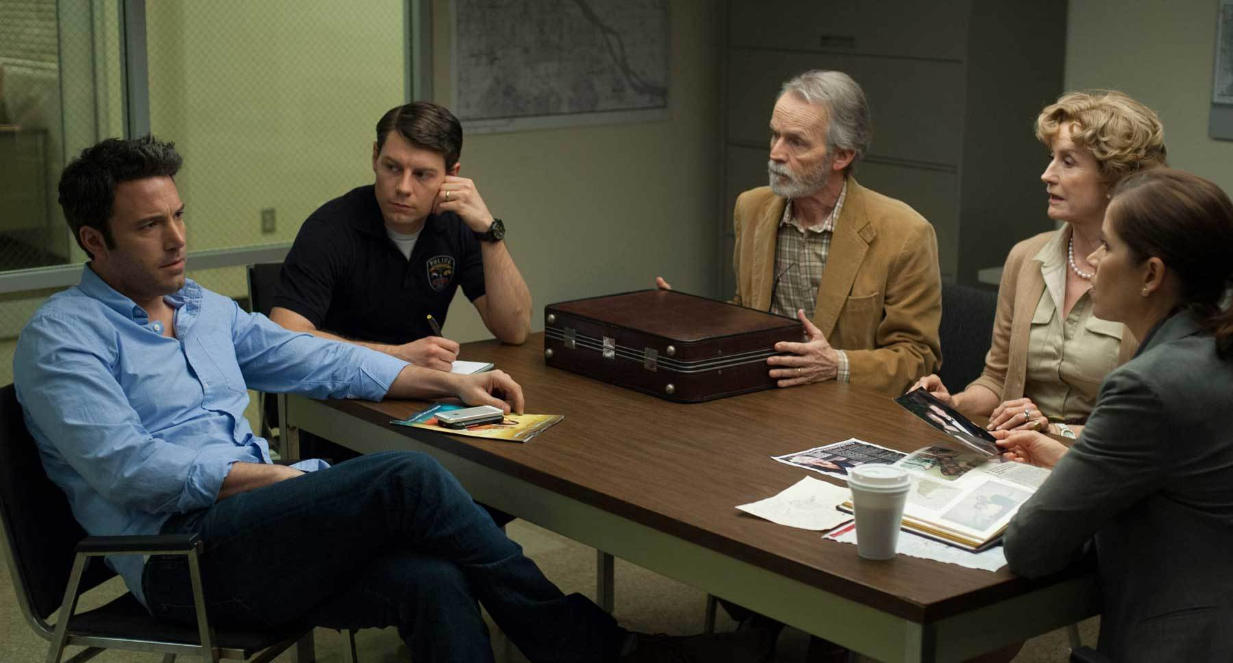 "Ben Affleck (Nick), Lisa Banes (Marybeth), David Clennon (Rand), Kim Dickens (Detective Boney), and Patrick Fugit (Officer James) in ""Gone Girl"""