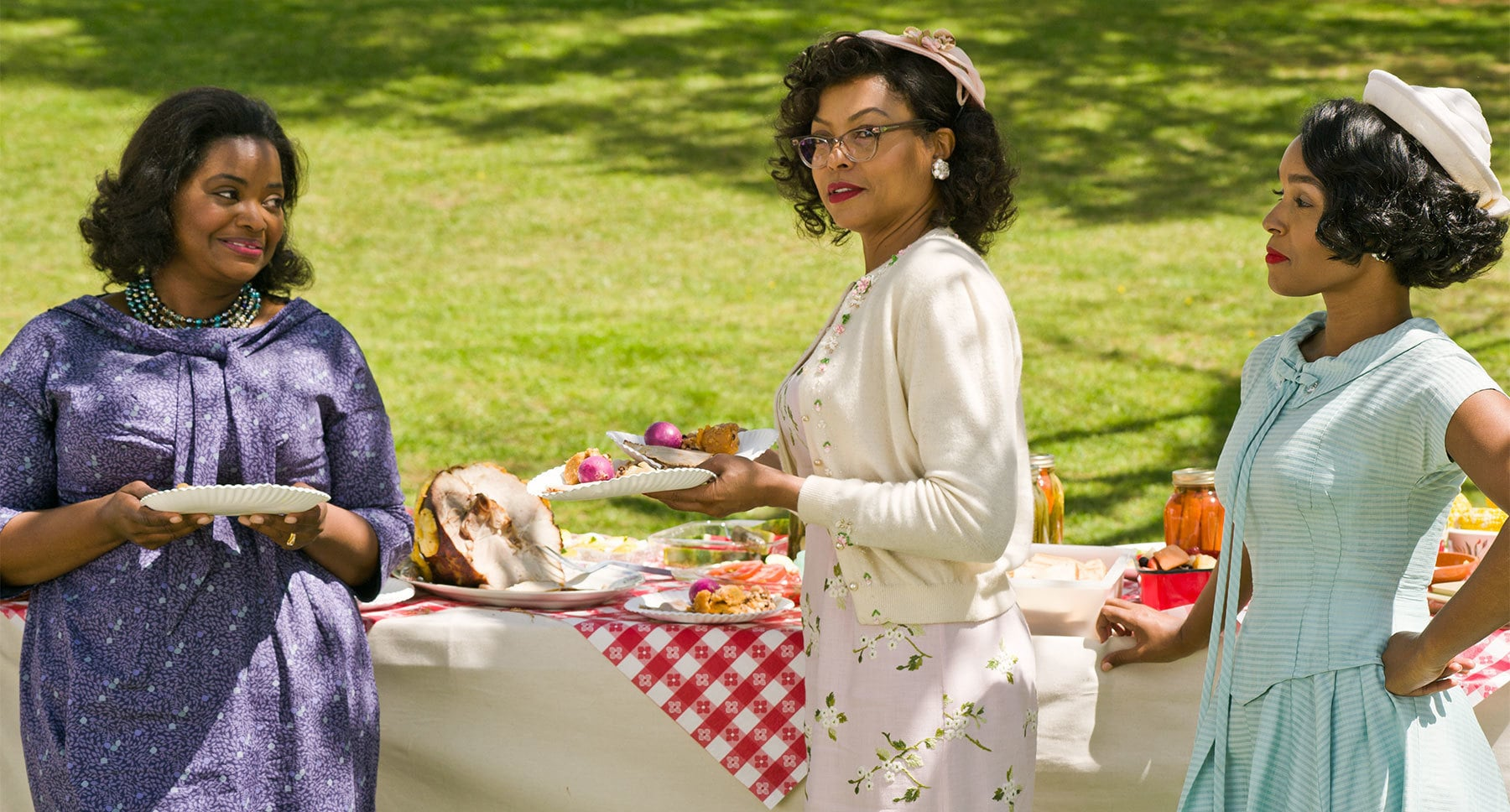 "Actors Octavia Spencer, Taraji P. Henson and Janelle Monáe at a picnic in the movie ""Hidden Figures"""