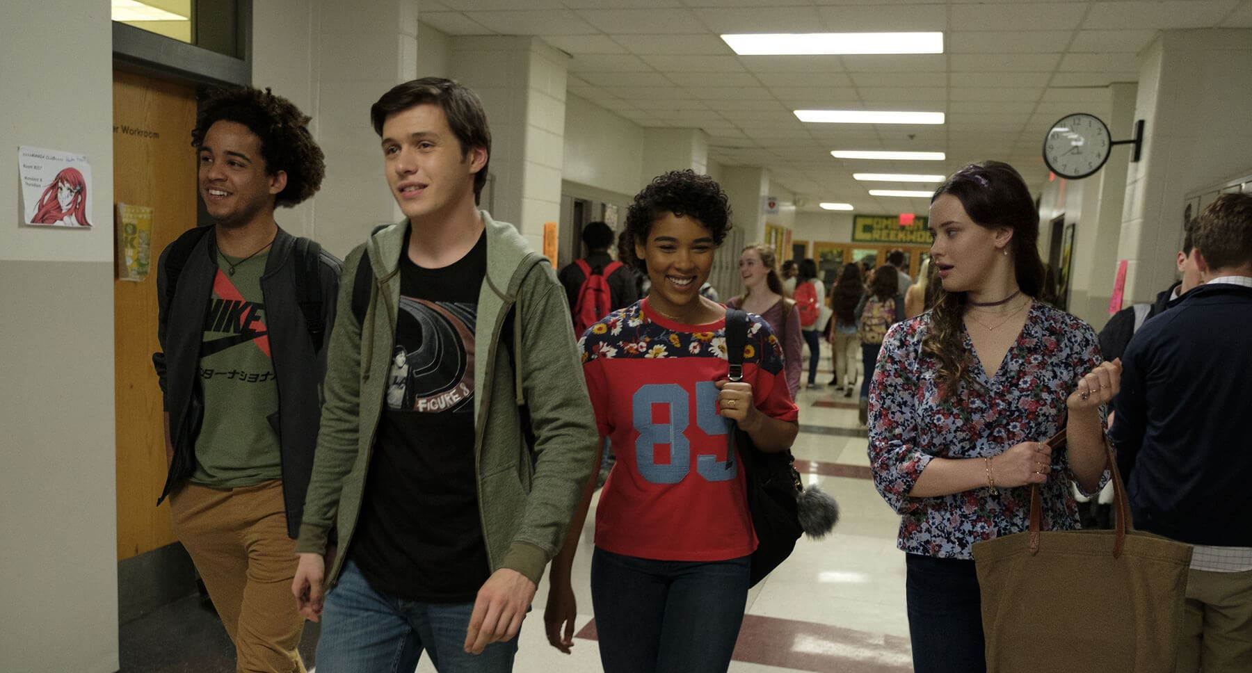 "Alexandra Shipp (as Abby), Nick Robinson (as Simon), Jorge Lendeborg Jr. (as Nick), and Katherine Langford (as Leah) walking in a school hallway in ""Love, Simon"""