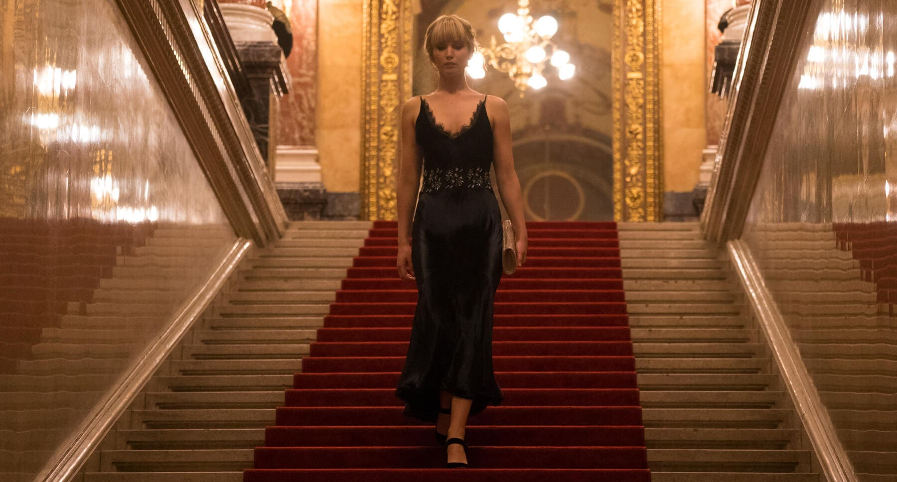 "Jennifer Lawrence (as Dominika Egorova) descending a staircase in ""Red Sparrow"""