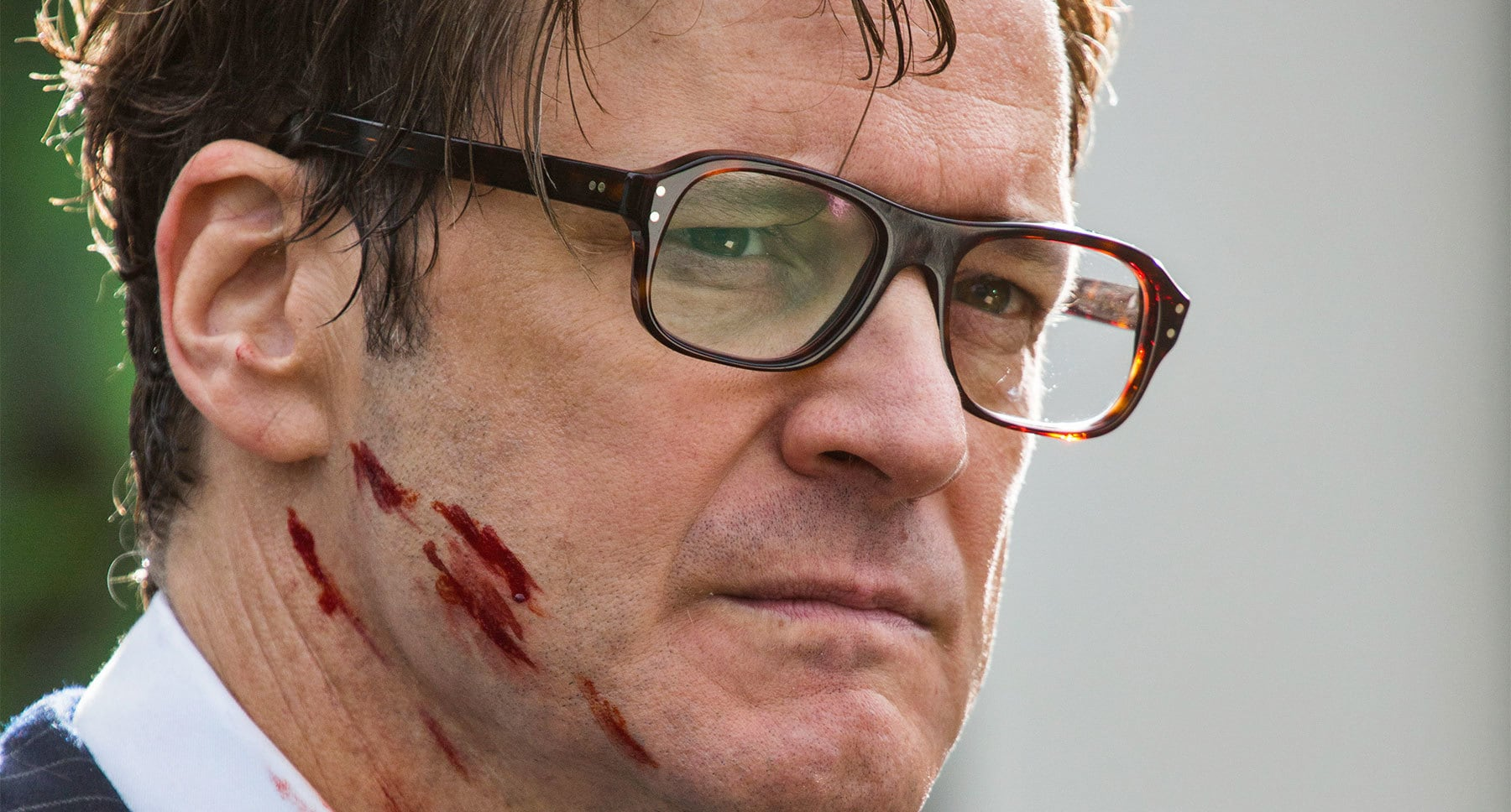 "Colin Firth (Galahad) with a blood on his face in ""Kingsman: The Secret Service"""