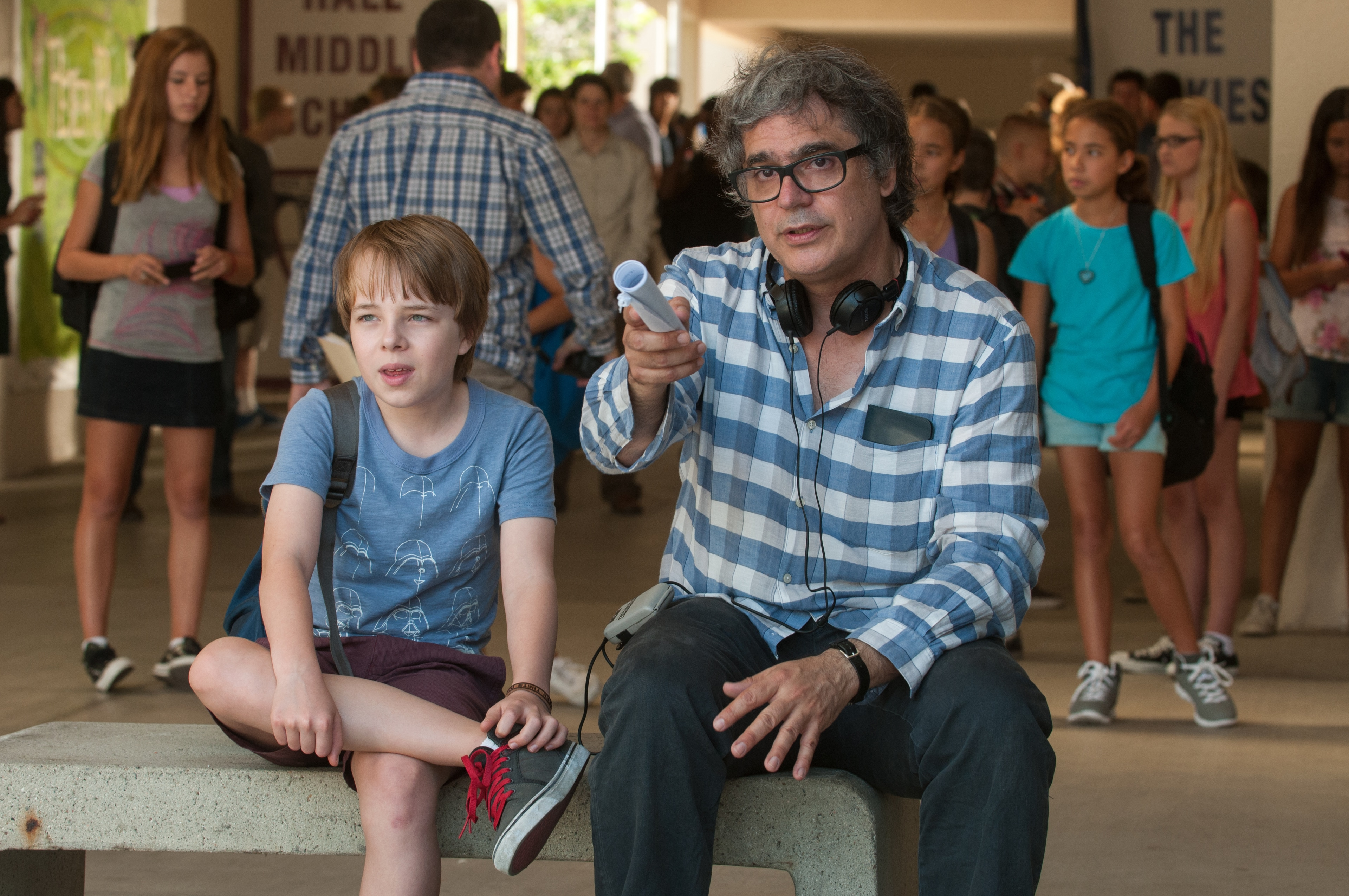 Ed Oxenbould and director Miguel Arteta sitting together on set of Alexander and the Terrible, Horrible, No Good, Very Bad Day