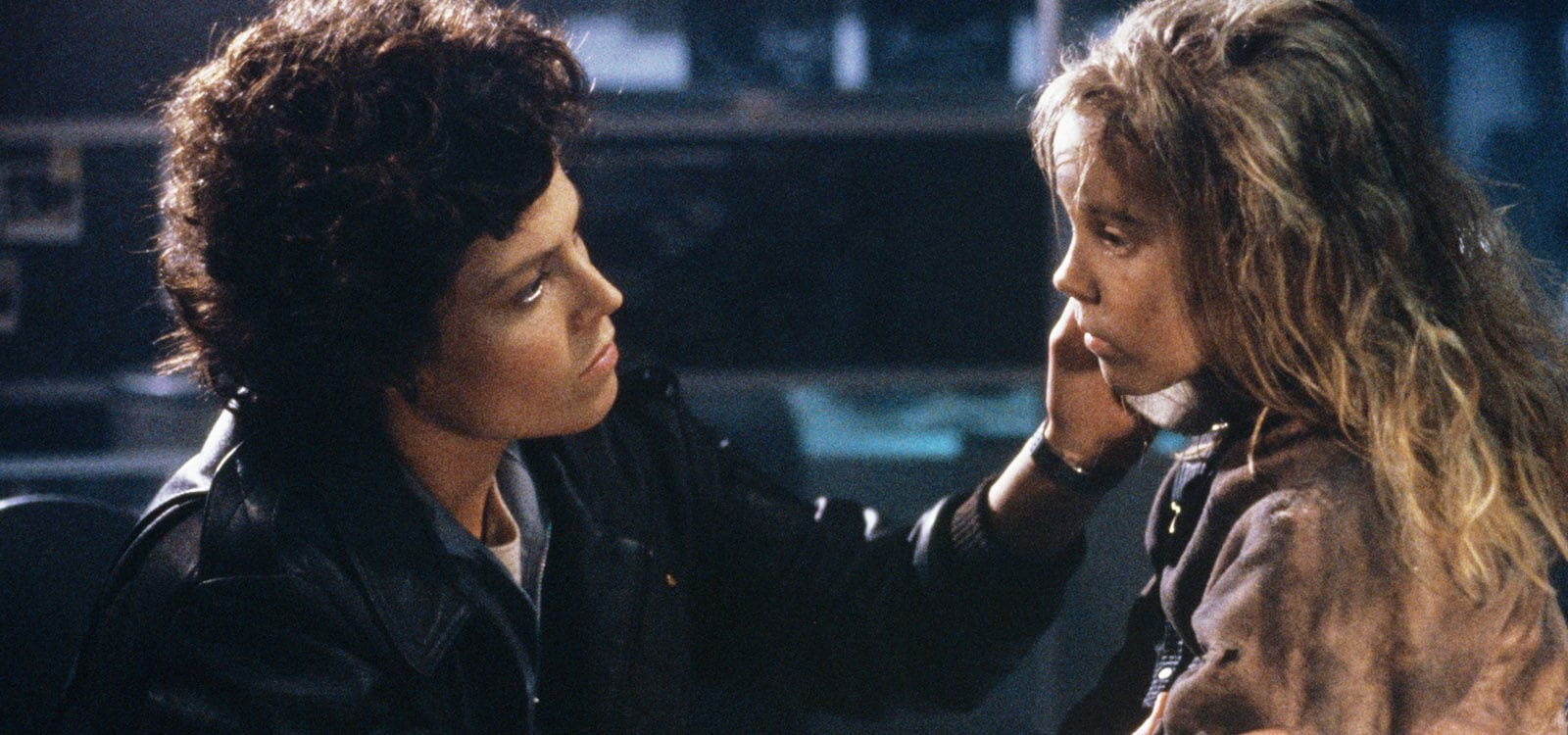 "Actors Sigourney Weaver (as Ridley) and Carrie Henn (as Newt) in the film ""Aliens"""
