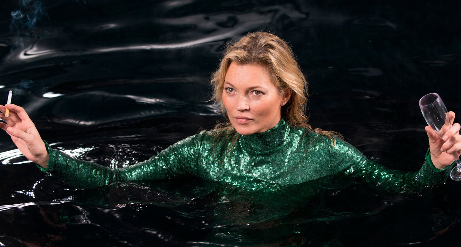 "Actor Kate Moss as herself, chest deep in water in ""Absolutely Fabulous: The Movie"""
