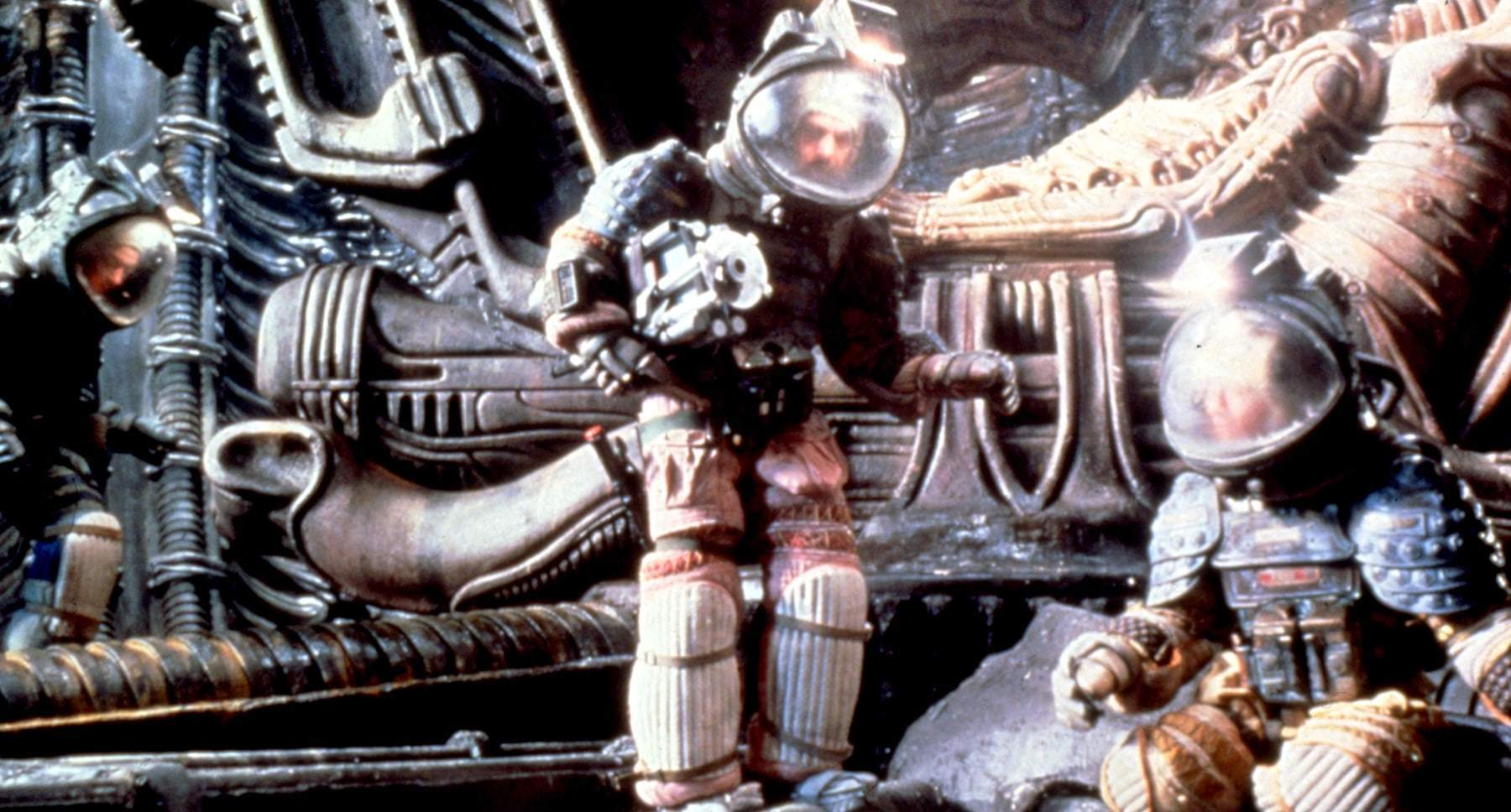 "Three characters in space suits in the movie ""Alien"""