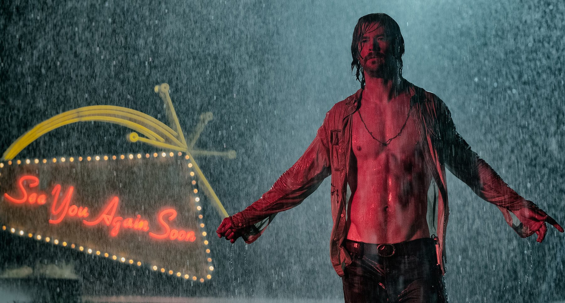 "Actor Chris Hemsworth (as Billy Lee) standing in the rain  in the movie "" Bad Times At The El Royale"""