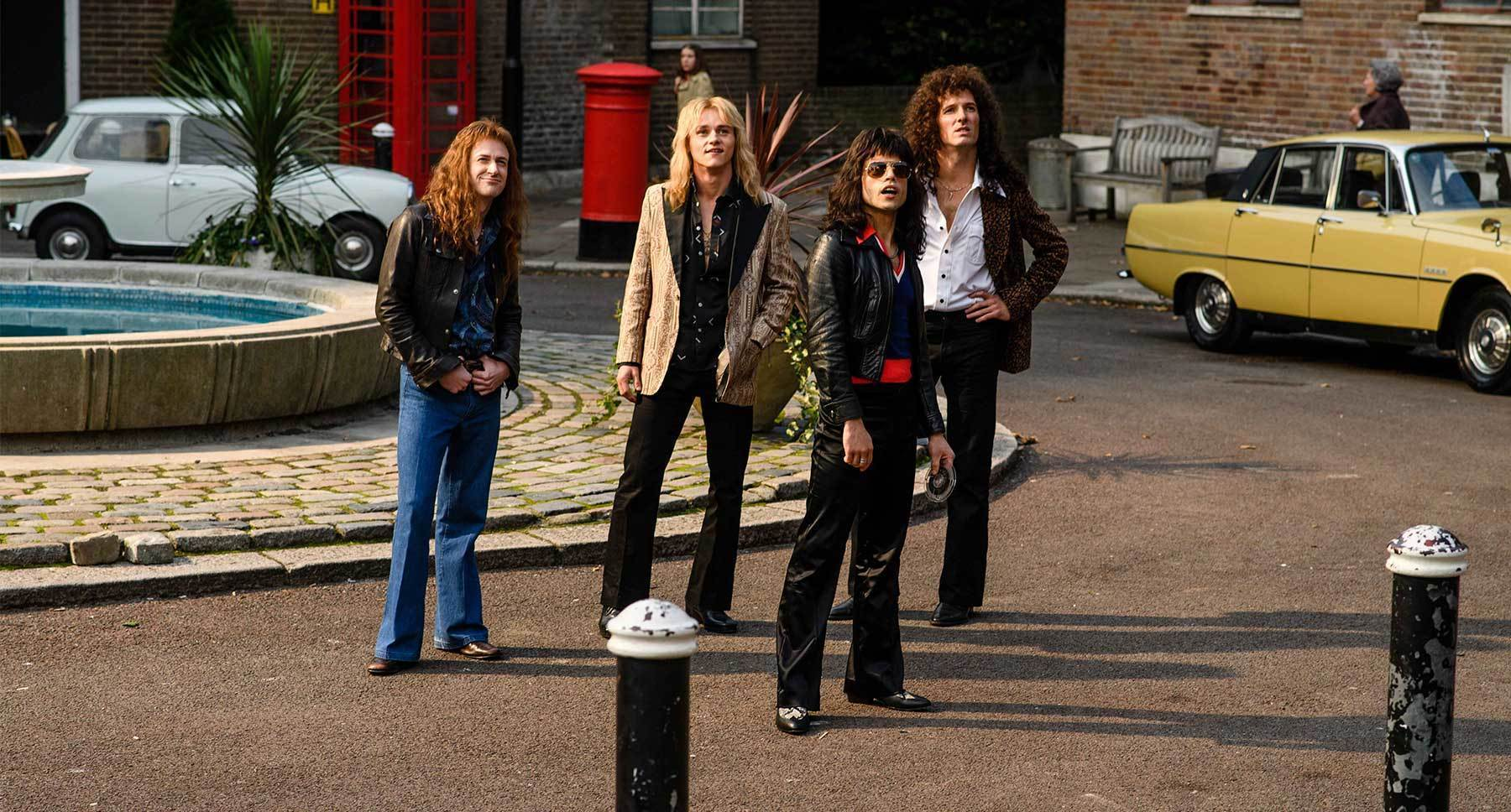 "Rami Malek (as Freddie Mercury) Gwilym Lee (as Brian May), Ben Hardy (as Roger Taylor), and  Joseph Mazzello (as John Deacon) in the movie ""Bohemian Rhapsody"""