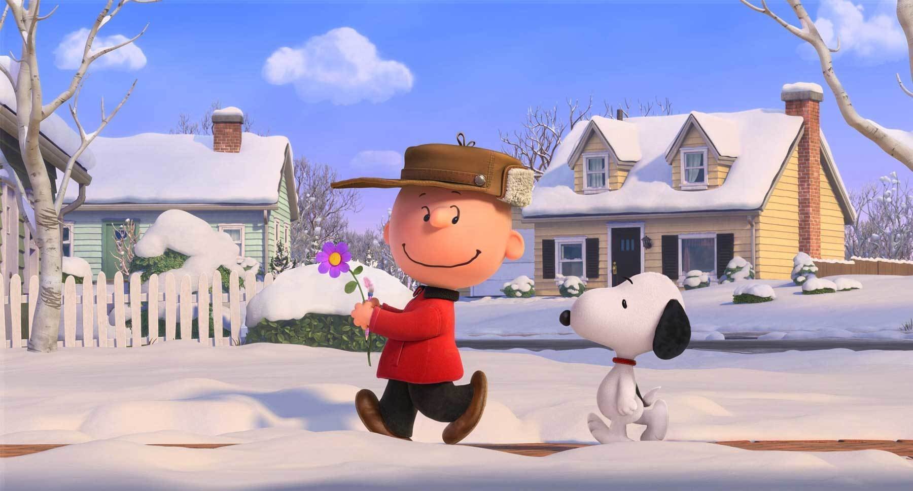 "Snoopy (voiced by Bill Melendez) and Charlie Brown (voiced by Noah Schnapp) walking together in the snow in a scene from ""The Peanuts Movie"""
