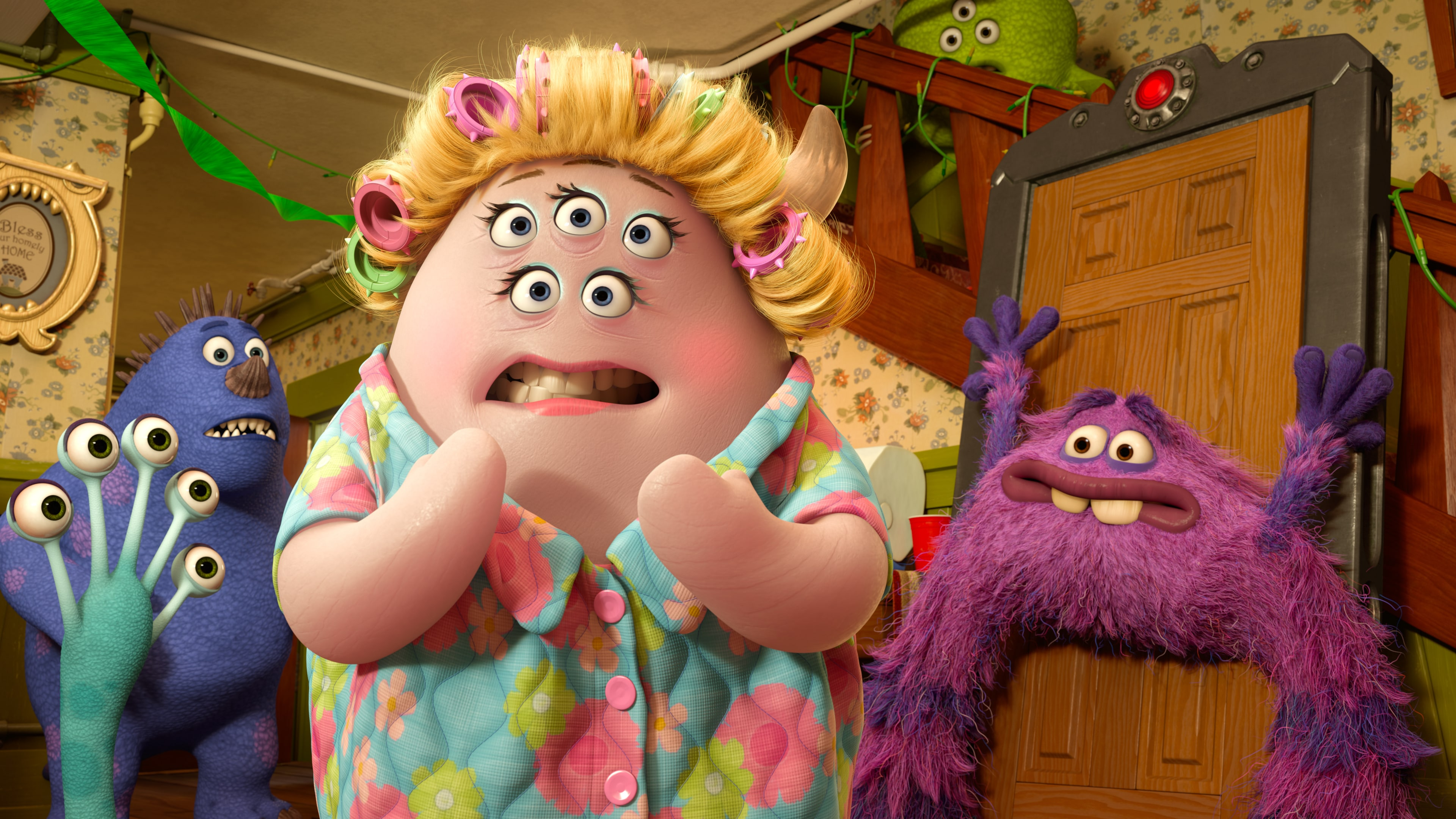 Ms. Squibbles (voiced by Julia Sweeney) and Art (voiced by Charlie Day) in the Disney•Pixar movie Party Central.