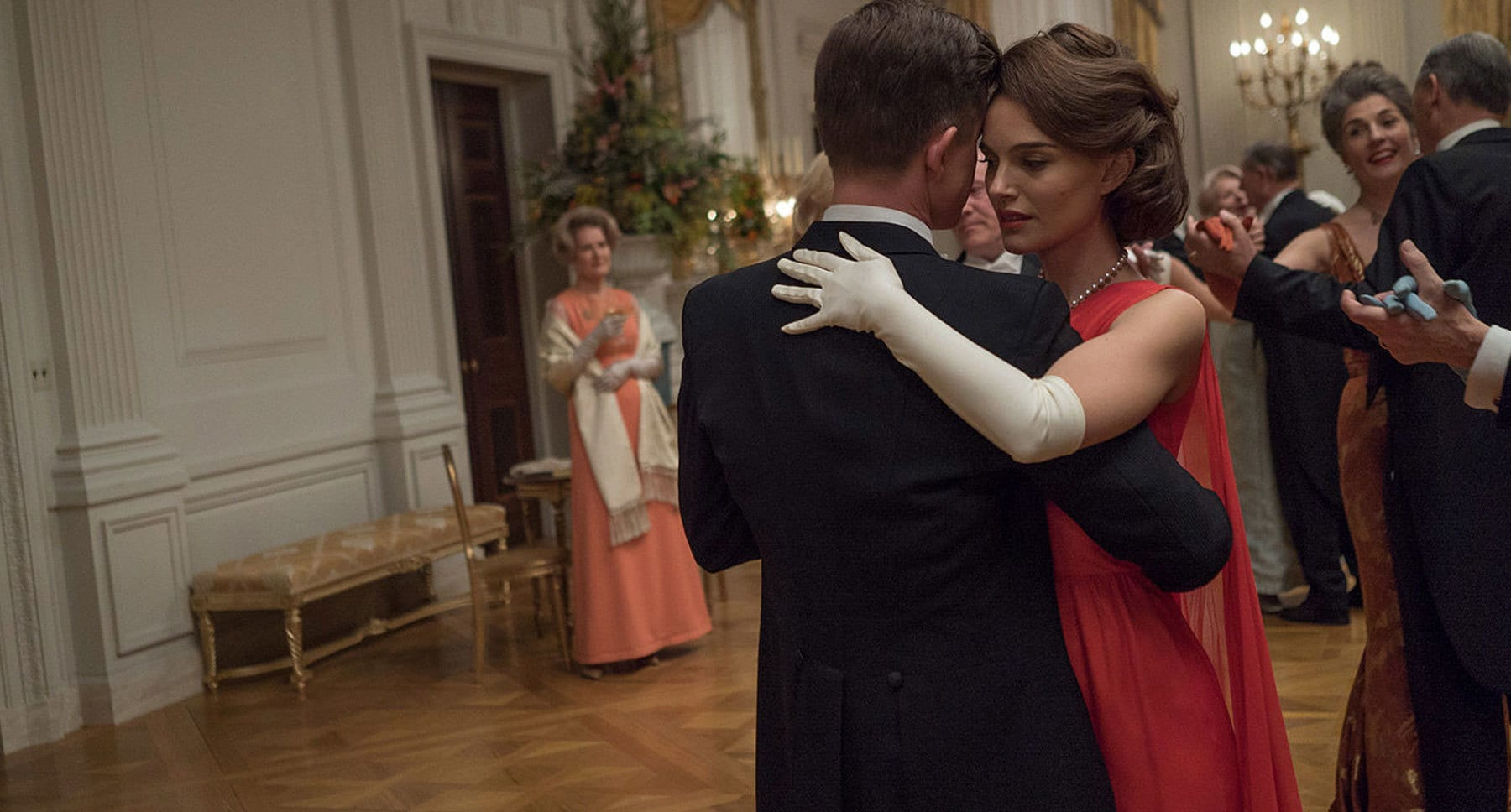 "Natalie Portman (as Jackie) and Caspar Phillipson (as John F. Kennedy) dancing together in ""Jackie"""