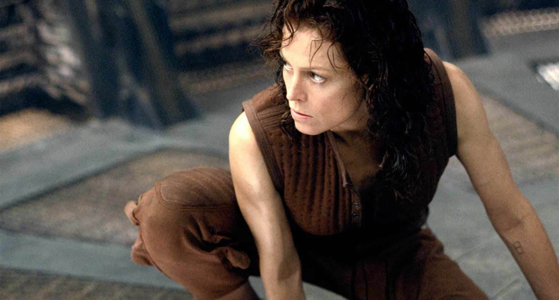 "Actor Sigourney Weaver (as Ripley) crouching in the film ""Alien: Resurrection"""