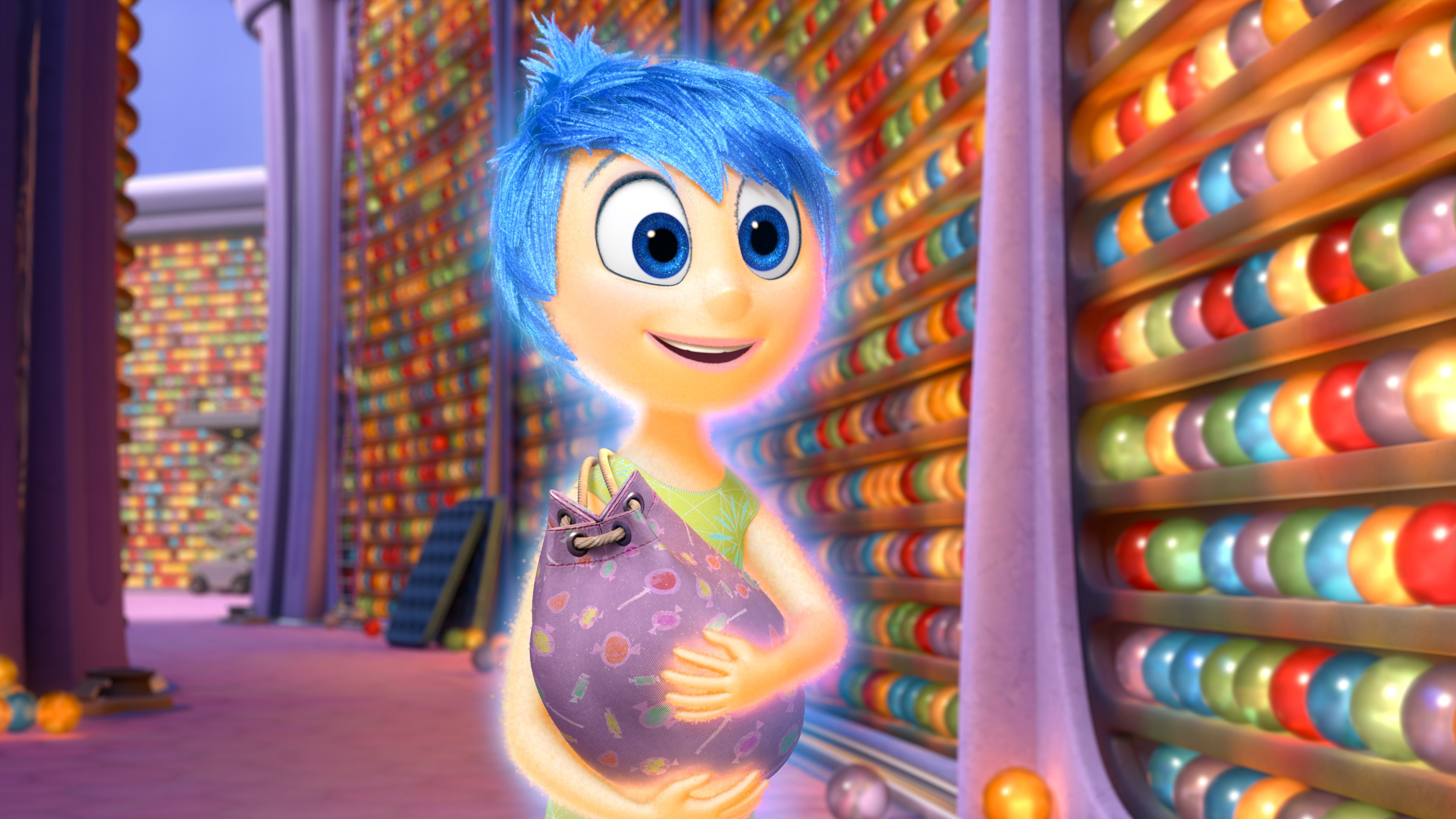 """Actor Amy Poehler as Joy holding memories in the movie """"Inside Out"""""""