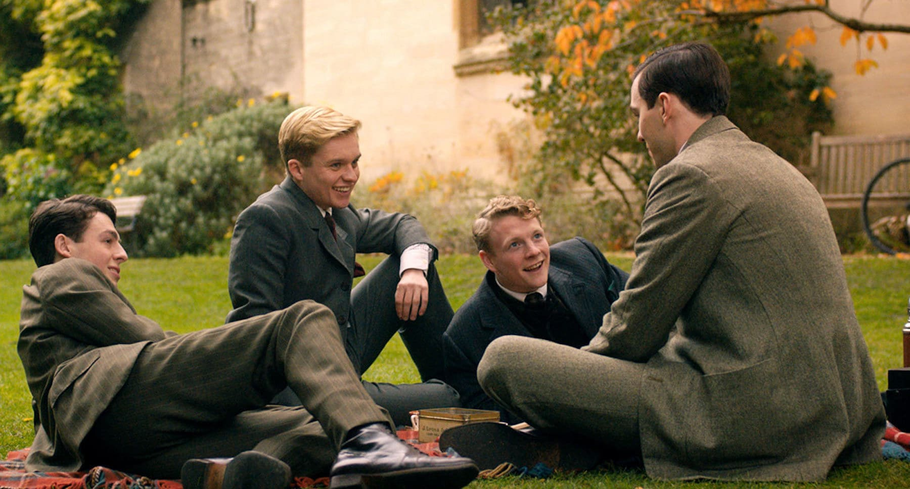 """Nicholas Hoult, Patrick Gibson, Anthony Boyle, and Tom Glynn-Carney at a picnic in """"Tolkien"""""""