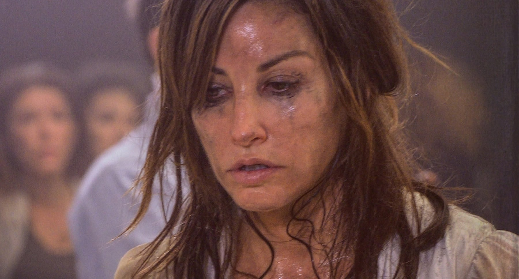 "Actress Gina Gershon (Eve) dirty and sweaty in the film ""9/11"""
